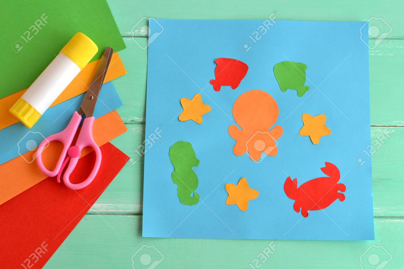 Paper applique with sea animals and fishes  Art lesson in kindergarten