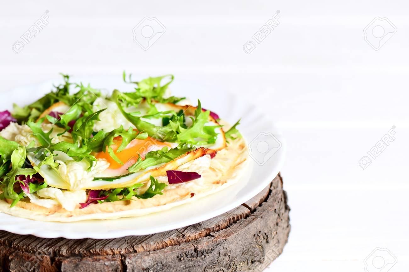 Home Tortilla With Fried Egg, Hummus And Fresh Salad Variety.. Stock ...