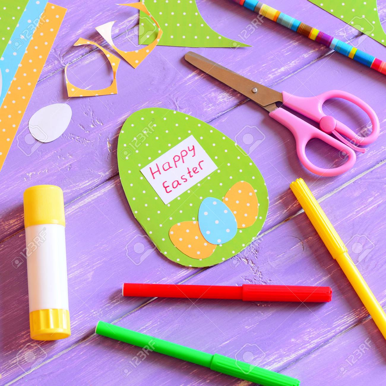 happy easter card in egg shape. materials and tools to create