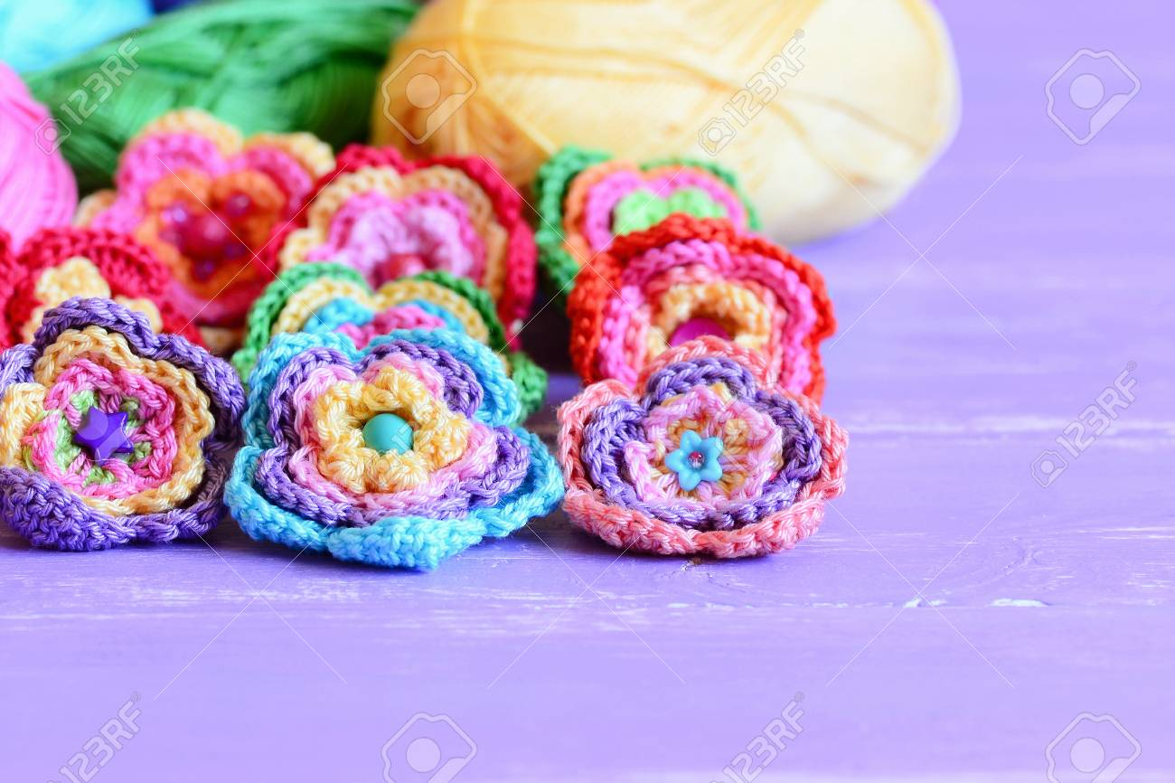 Crochet flowers embellished with buttons and beads beautiful crochet flowers embellished with buttons and beads beautiful crochet flowers colored cotton yarn on izmirmasajfo Image collections