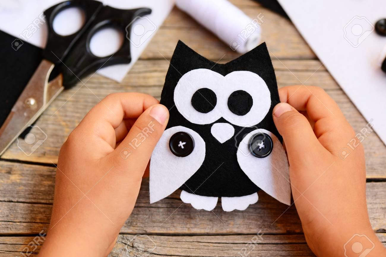 Small Child Holds A Felt Owl Toy In His Hands Child Shows A Stock