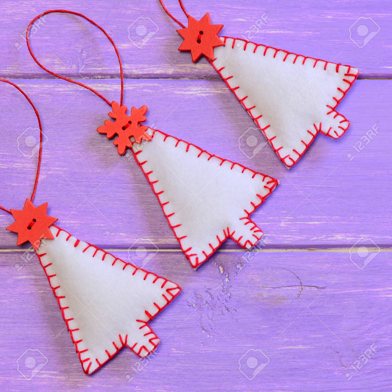 Christmas Trees Ornaments On A Purple Wooden Background Handmade