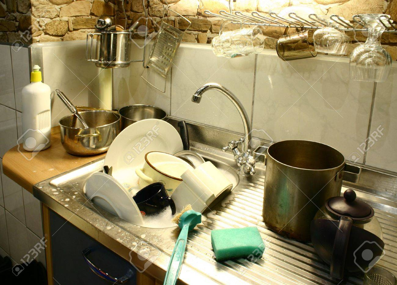 Kitchen Sink With Dishes lots of dirty dishes in small kitchen's sink stock photo, picture