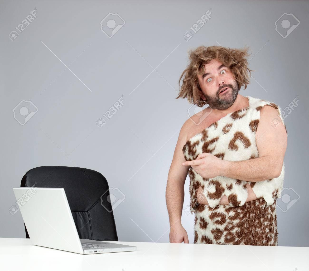 funny perplex prehistoric man using laptop - 57921516
