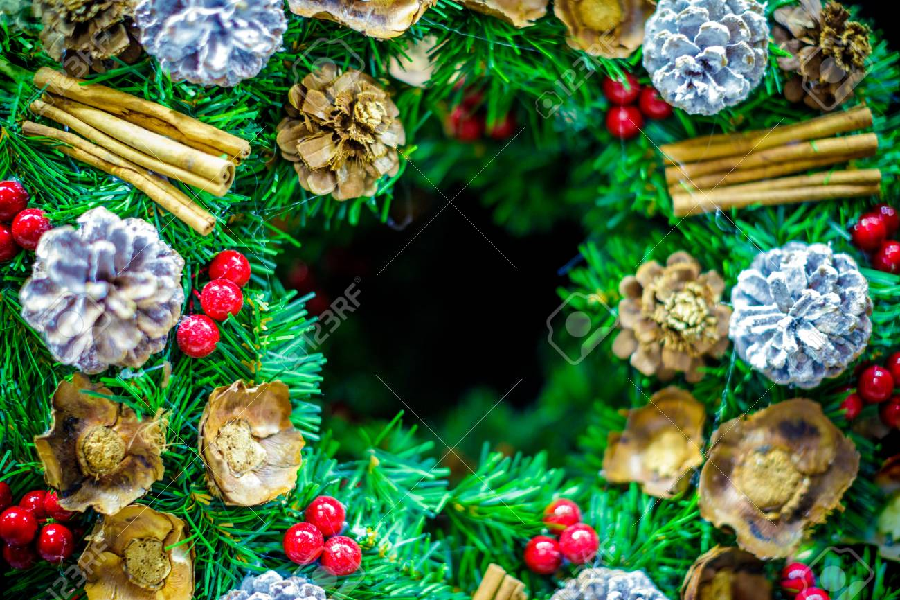 Detail Of Christmas Wreath Ornament With Decorations And Center