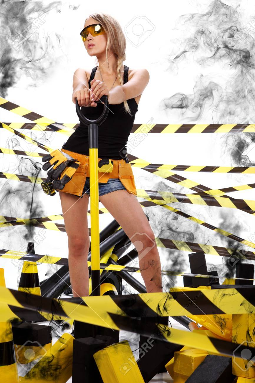 Female construction worker . Black and yellow concept. Stock Photo - 5406566