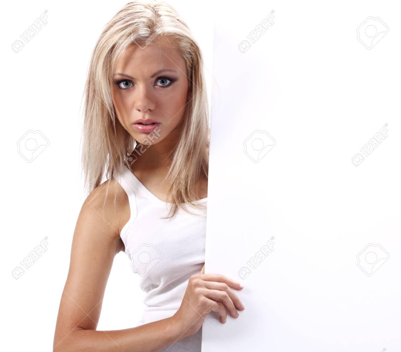 Beautiful blonde girl showing empty white board Stock Photo - 5613001