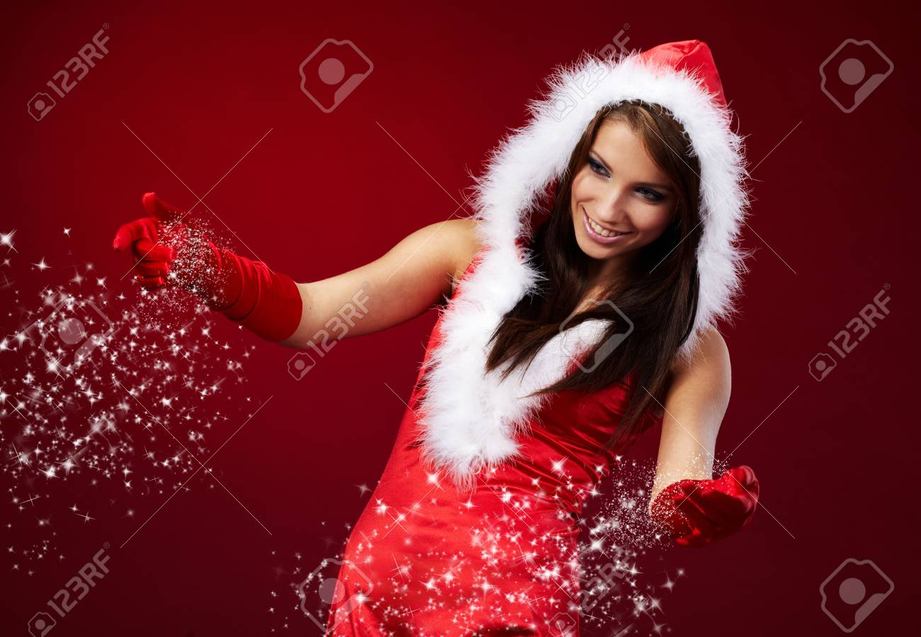 Portrait of beautiful sexy girl wearing santa claus clothes on red background Stock Photo - 7762435