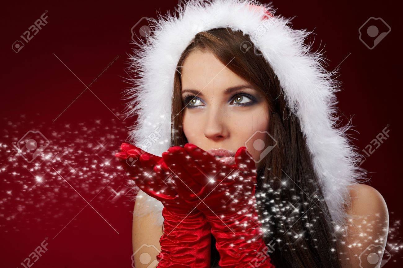 Portrait of beautiful sexy girl wearing santa claus clothes on red background Stock Photo - 5879118
