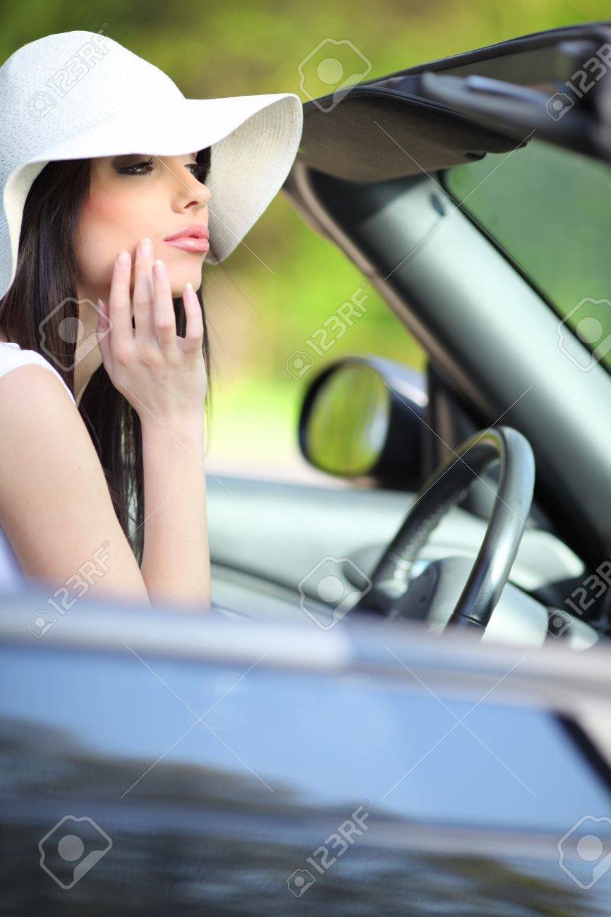 portrait of beautiful summer woman in the cabrio car Stock Photo - 7375480
