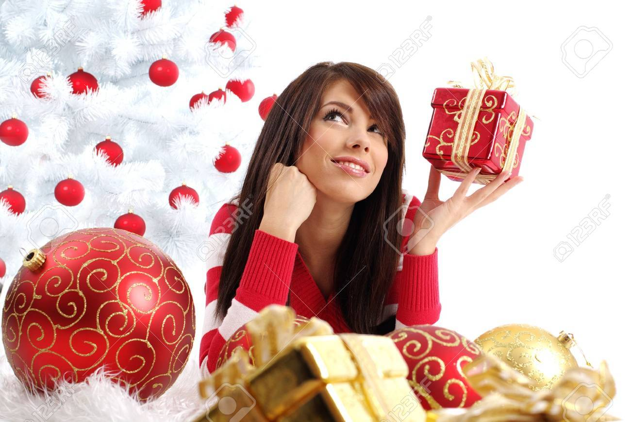 Beautiful girl with gift box next to white christmas tree Stock Photo - 7762335