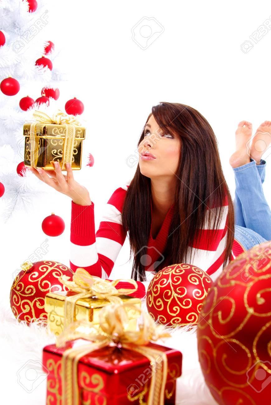 Beautiful girl with gift box next to white christmas tree Stock Photo - 7762347