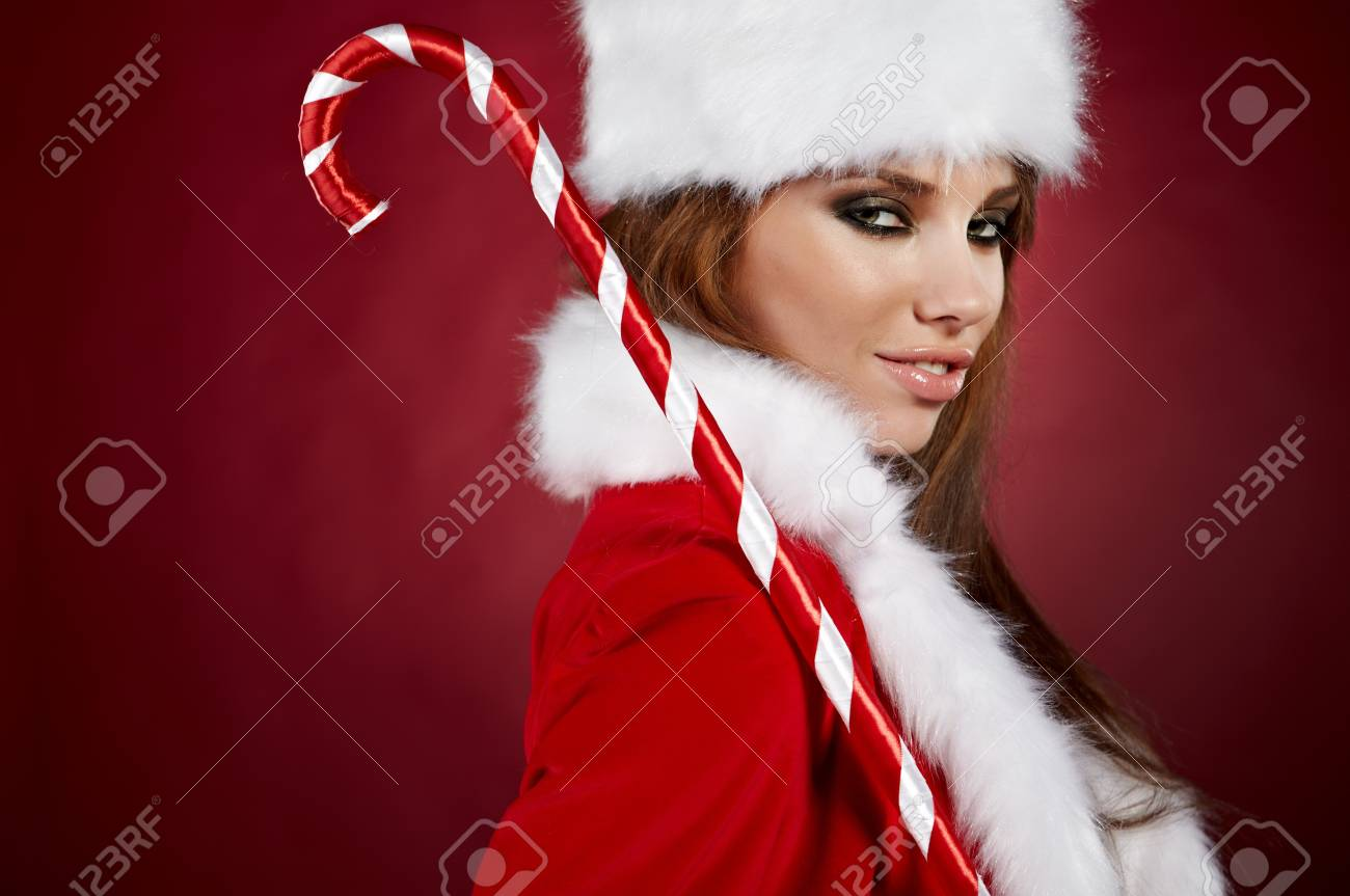 Portrait of beautiful sexy girl wearing santa claus clothes Stock Photo - 7887260