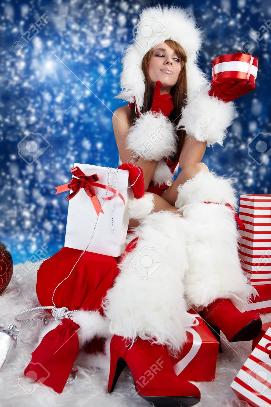Portrait of beautiful sexy girl wearing santa claus clothes Stock Photo - 8123362
