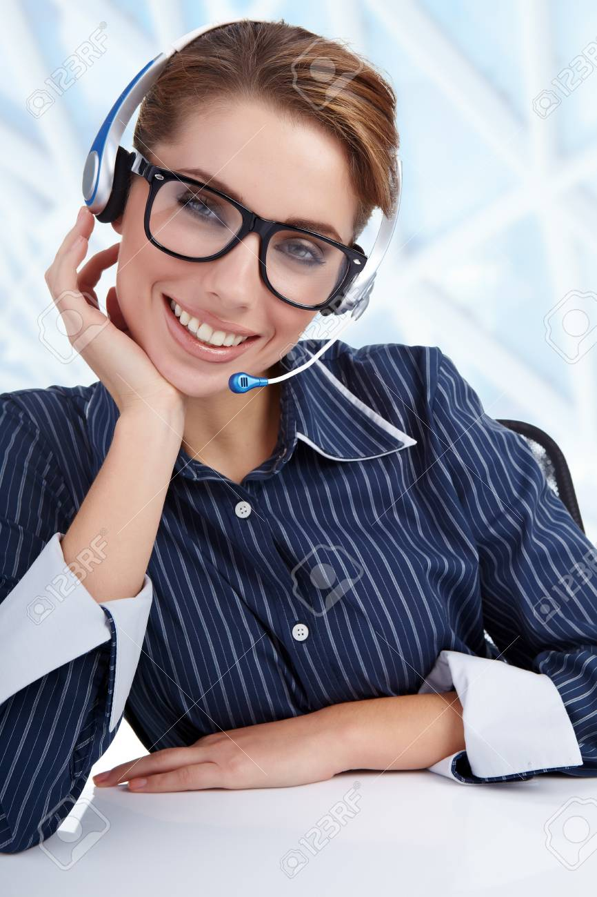 Support phone operator in headset at workplace Stock Photo - 8539693