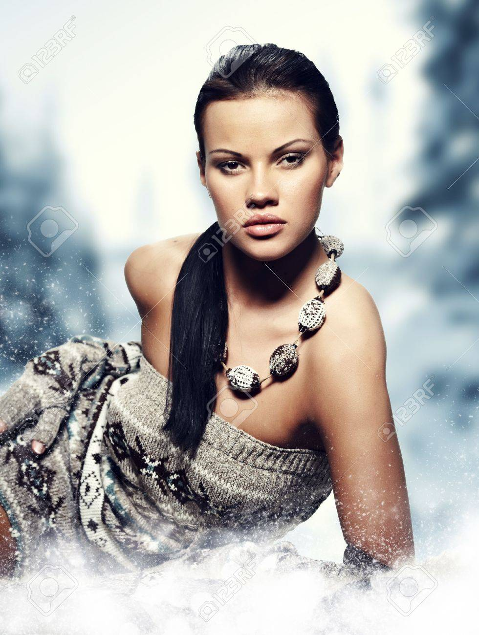 Winter wild woman on snow Stock Photo - 8587317
