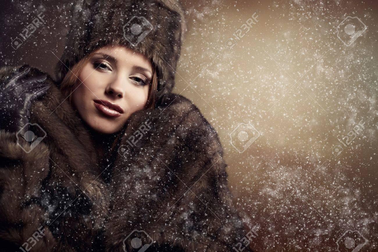 beautiful woman in a fur coat Stock Photo - 8630900