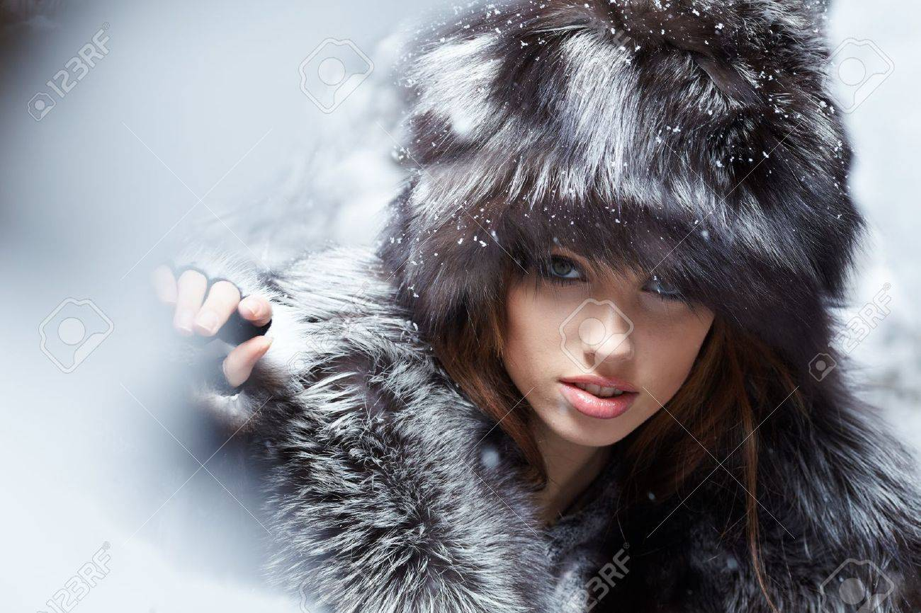Beautiful and sexy woman in snowy winter outdoors Stock Photo - 8702836
