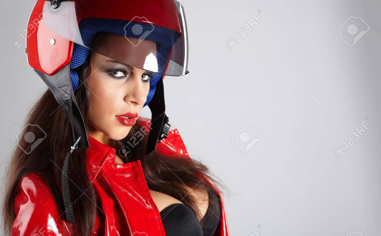 The beautiful girl with a motorcycle helmet Stock Photo - 8872727