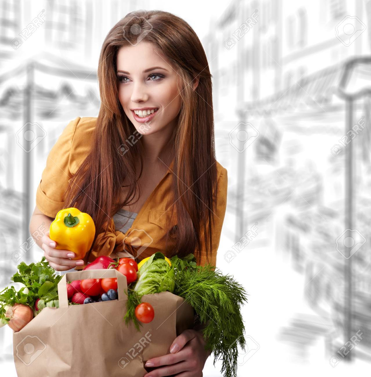 woman holding a bag full of healthy food. shopping . Stock Photo - 9110926
