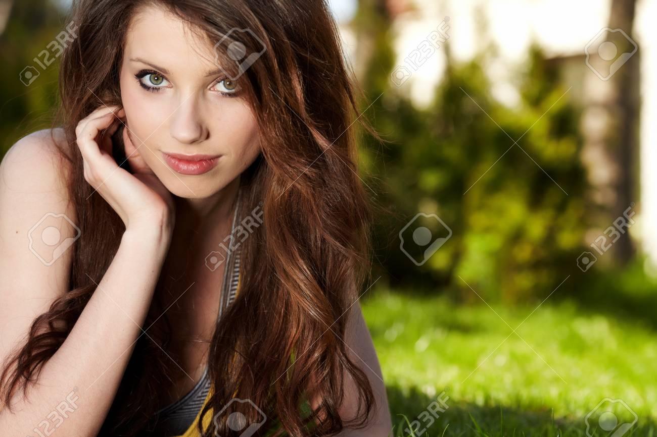 Smiling beautiful woman laying on grass Stock Photo - 9412331