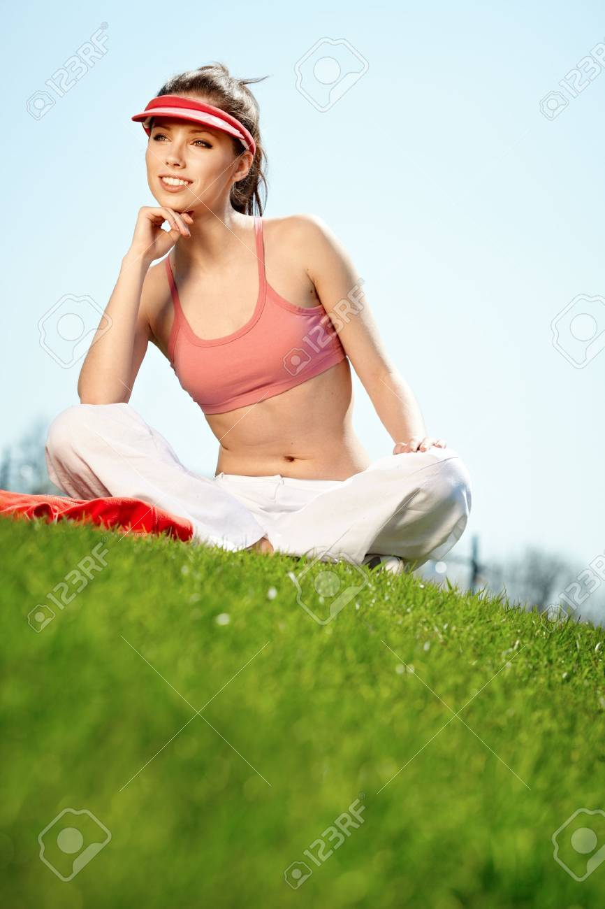Smiling fitness woman.Park  background Stock Photo - 9469895