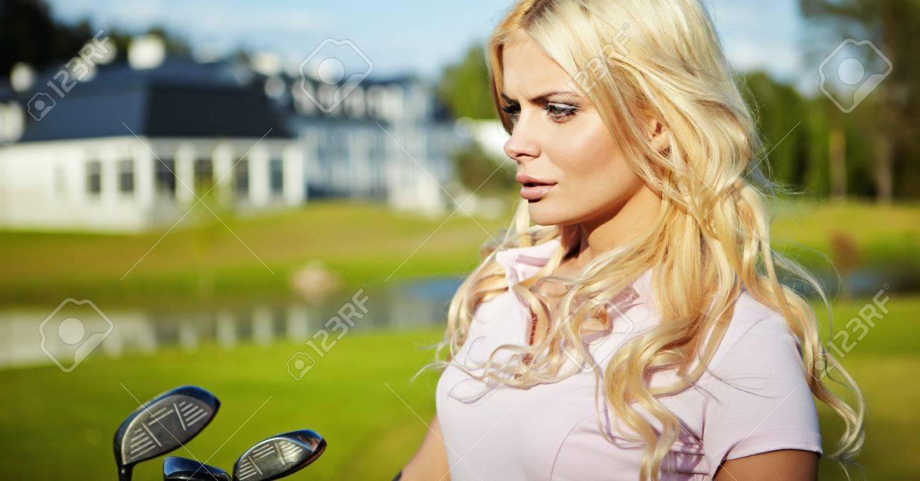 beauty blonde girl play golf Stock Photo - 9614330