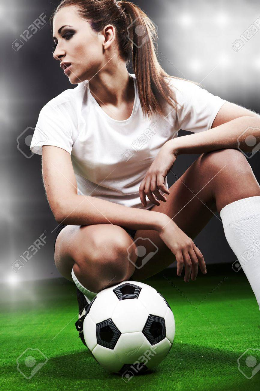 Sexy soccer player, woman on playing field Stock Photo - 10367639