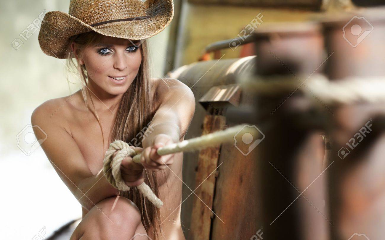 sexy woman with cowboy hat Stock Photo - 10478987 8884d36a302