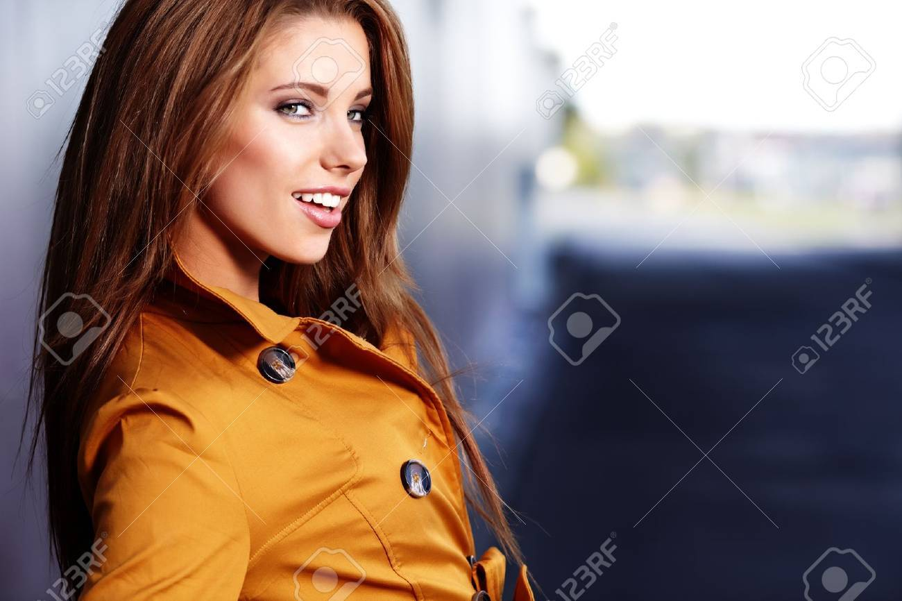 beautiful young  woman in autumn city Stock Photo - 10629605