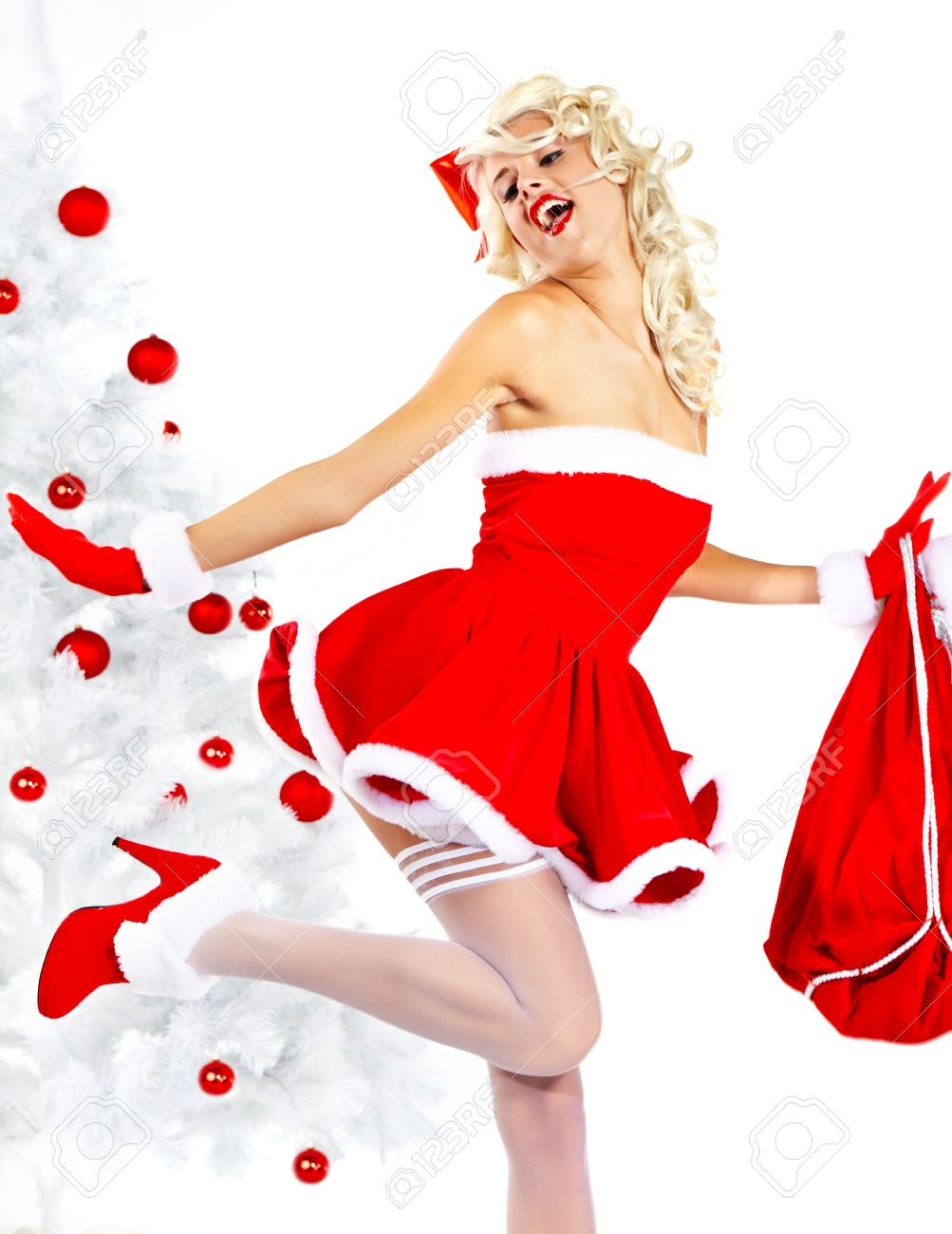 Pin-up sexy girl wearing santa claus clothes Stock Photo - 10967203