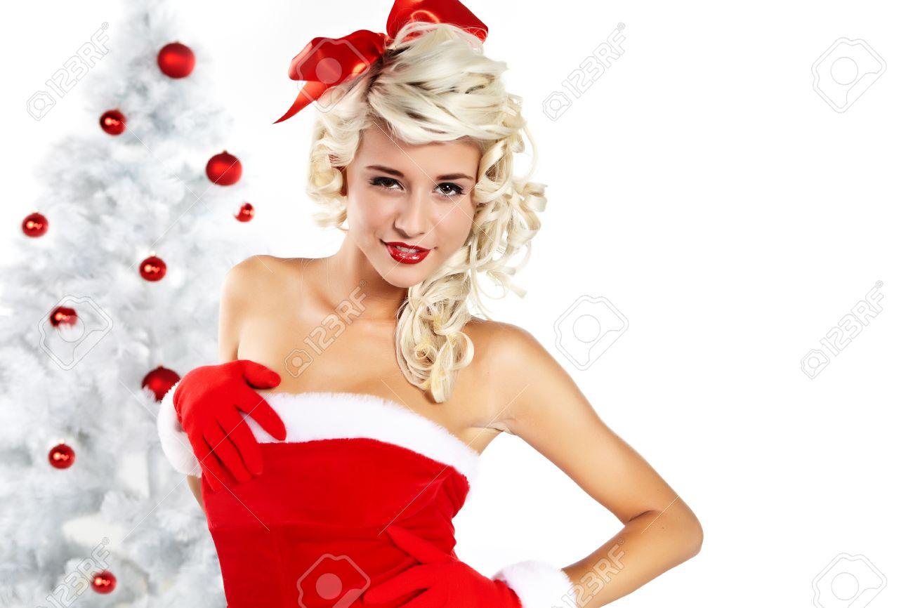 Pin-up sexy girl wearing santa claus clothes Stock Photo - 10967194