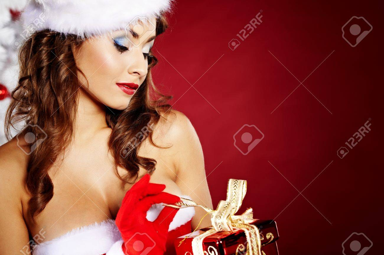 Portrait of beautiful sexy girl wearing santa claus clothes on red background Stock Photo - 11064817