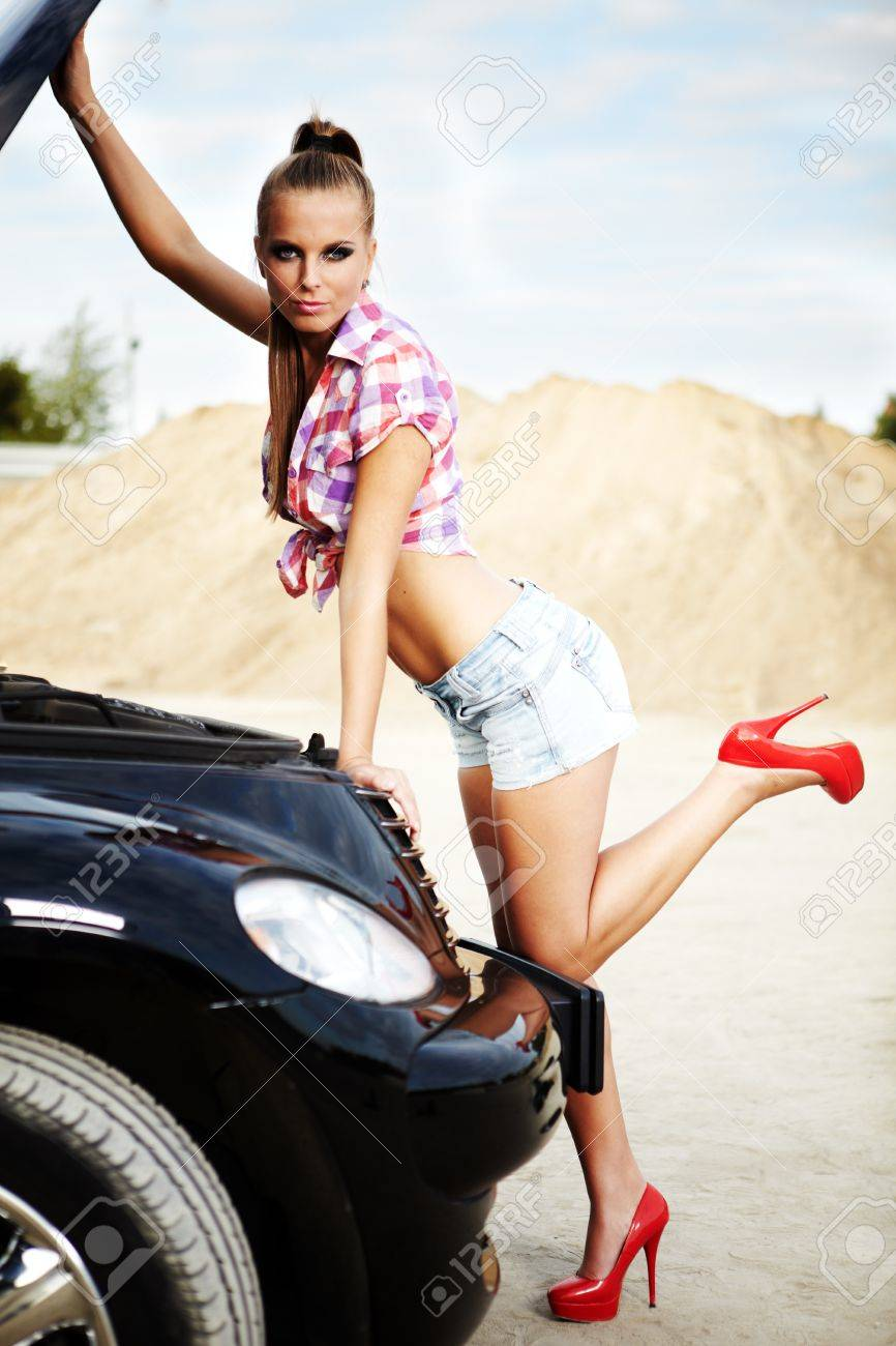 young sexy woman with her broken car. Stock Photo - 11064771