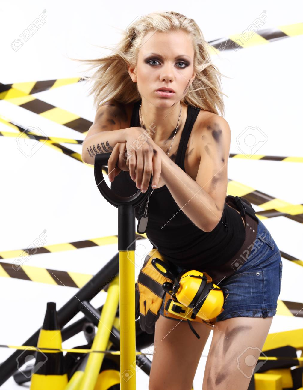 Female construction worker . Black and yellow concept. Stock Photo - 11292055
