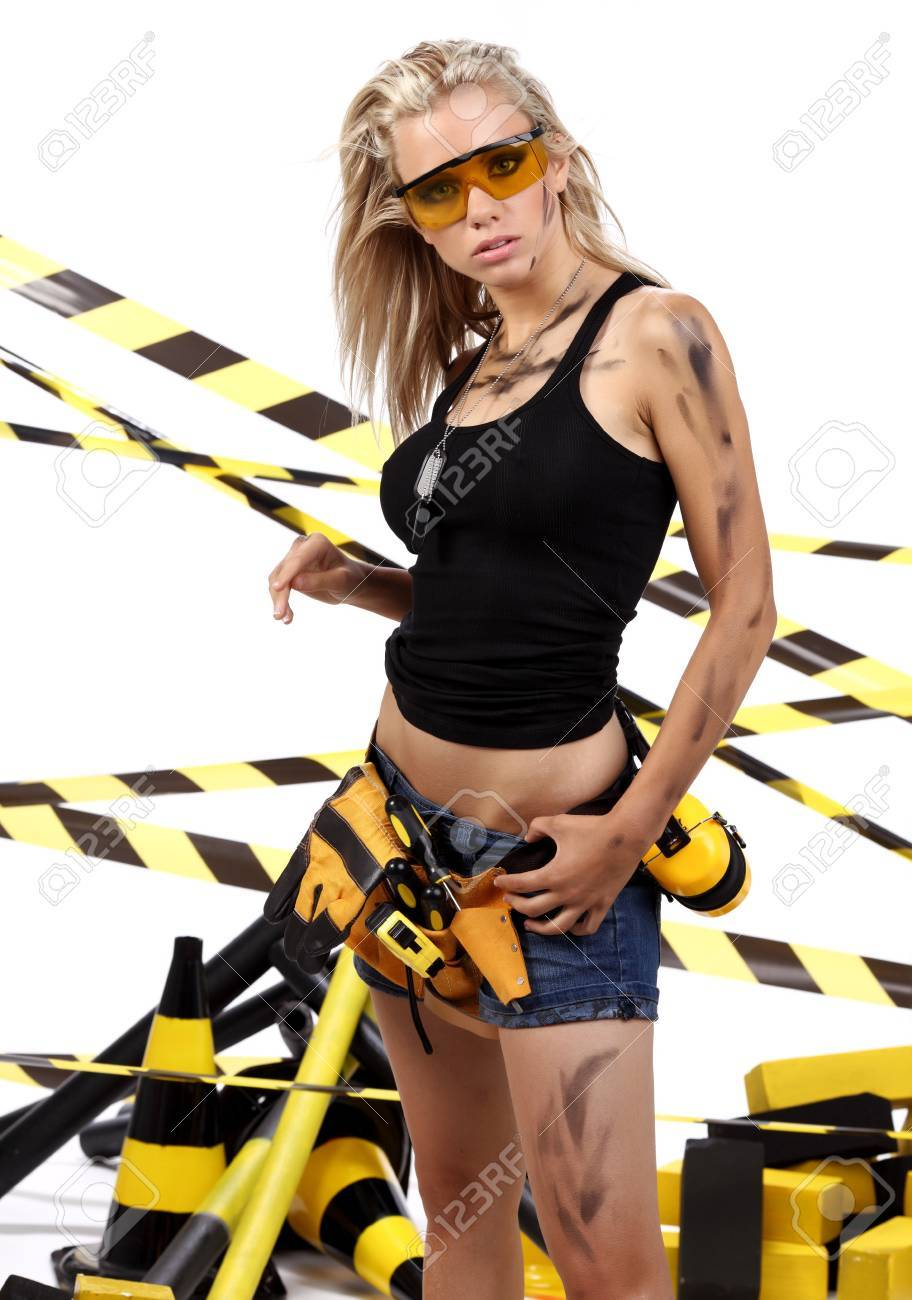 Female construction worker . Black and yellow concept. Stock Photo - 11292533