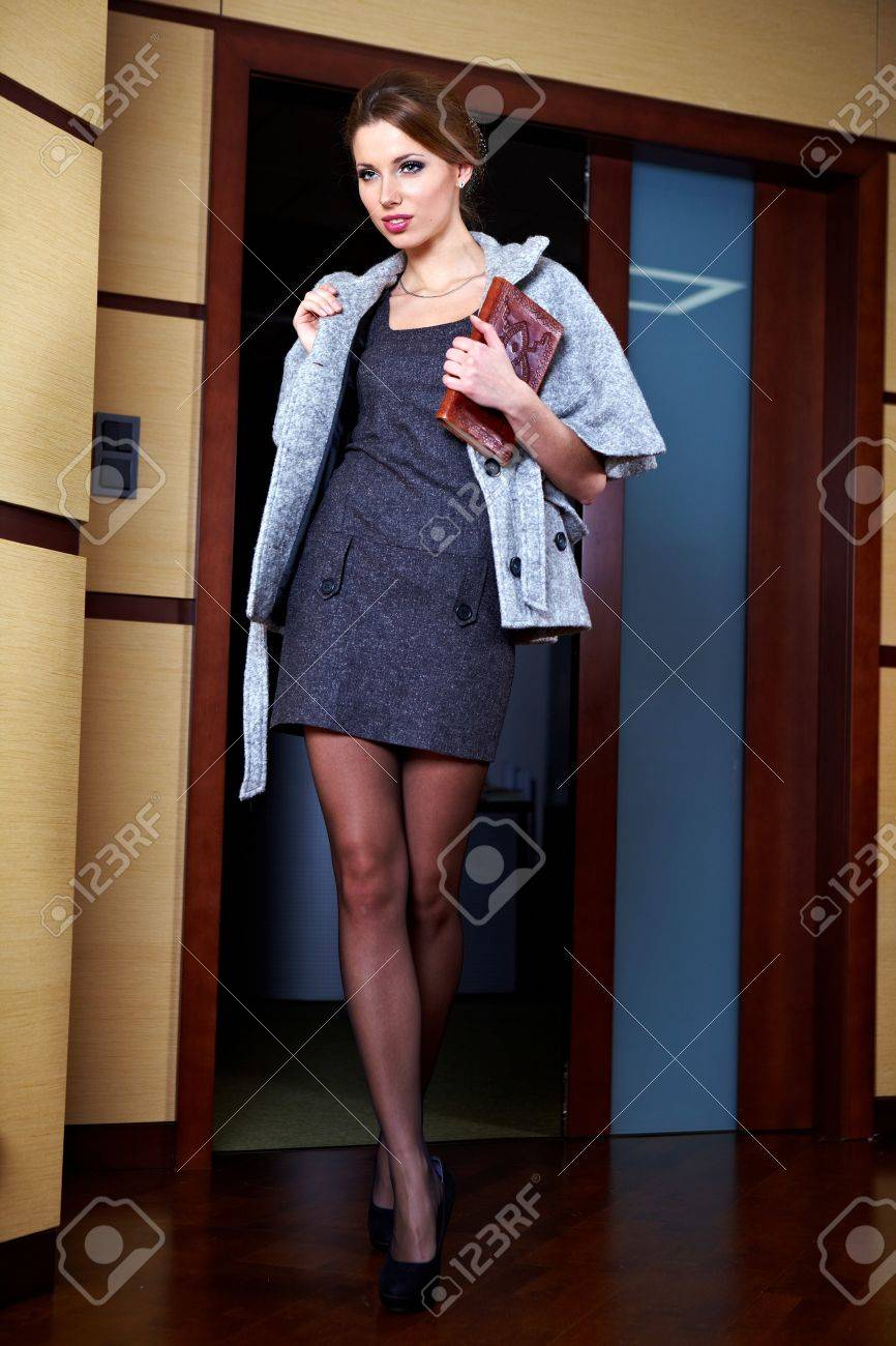 A portrait of a young business woman in an office Stock Photo - 11800117