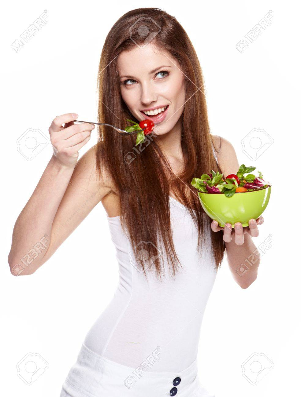 Woman with salad isolated on white Stock Photo - 13009845