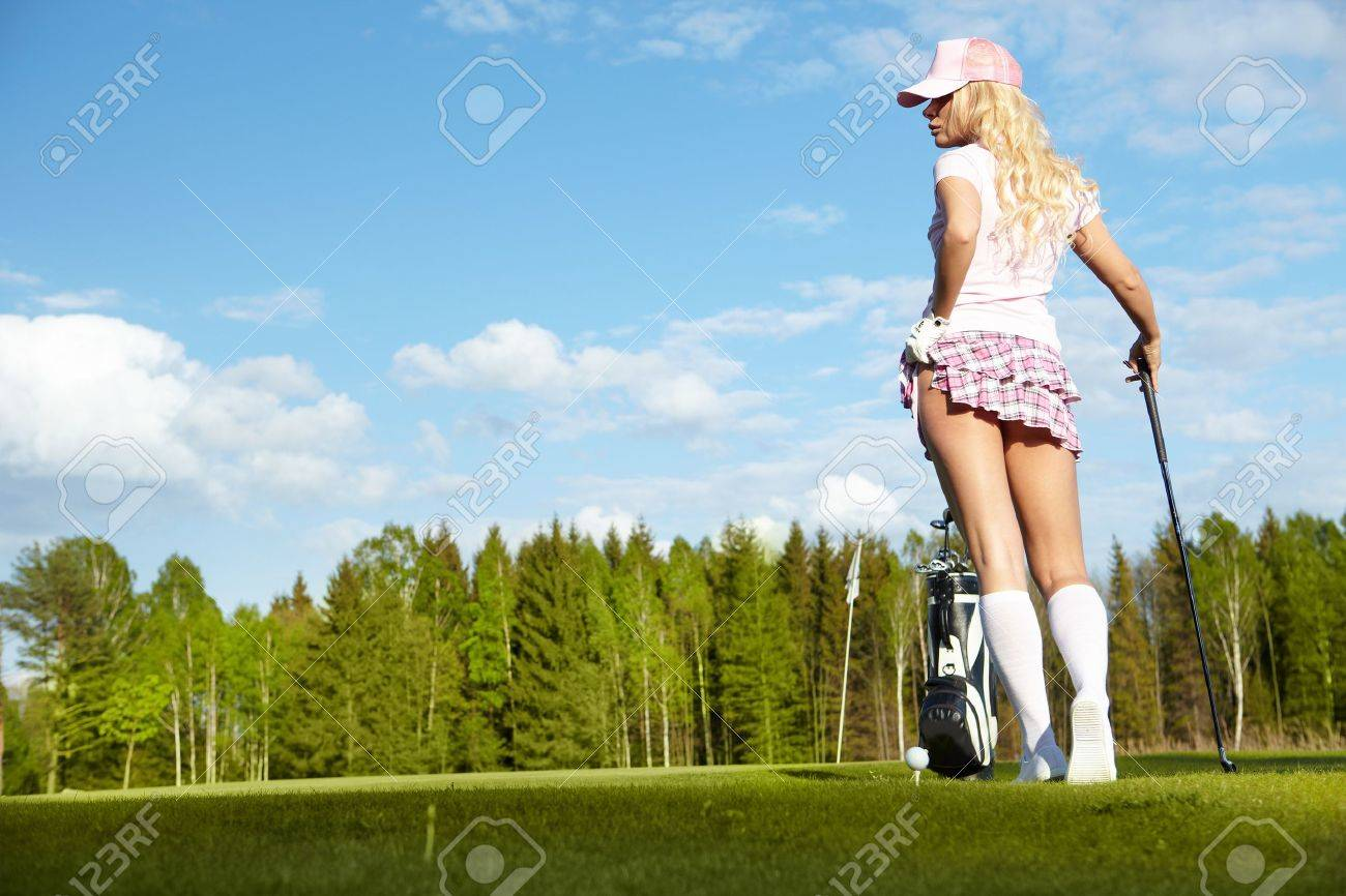 Young blonde  woman with golf equipment Stock Photo - 13009874