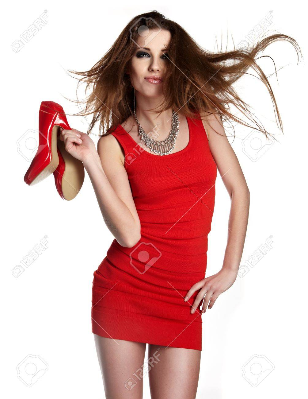 Beautiful woman after shopping holding shoes . Girl and shoe Stock Photo - 13273655