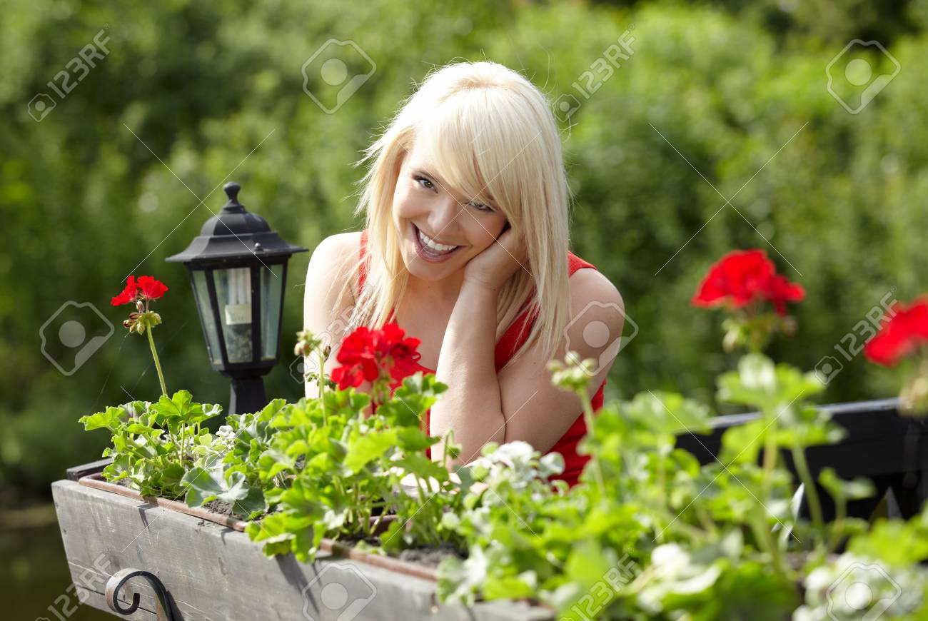 Beautiful  sexy young blonde woman in balcony Stock Photo - 13857110