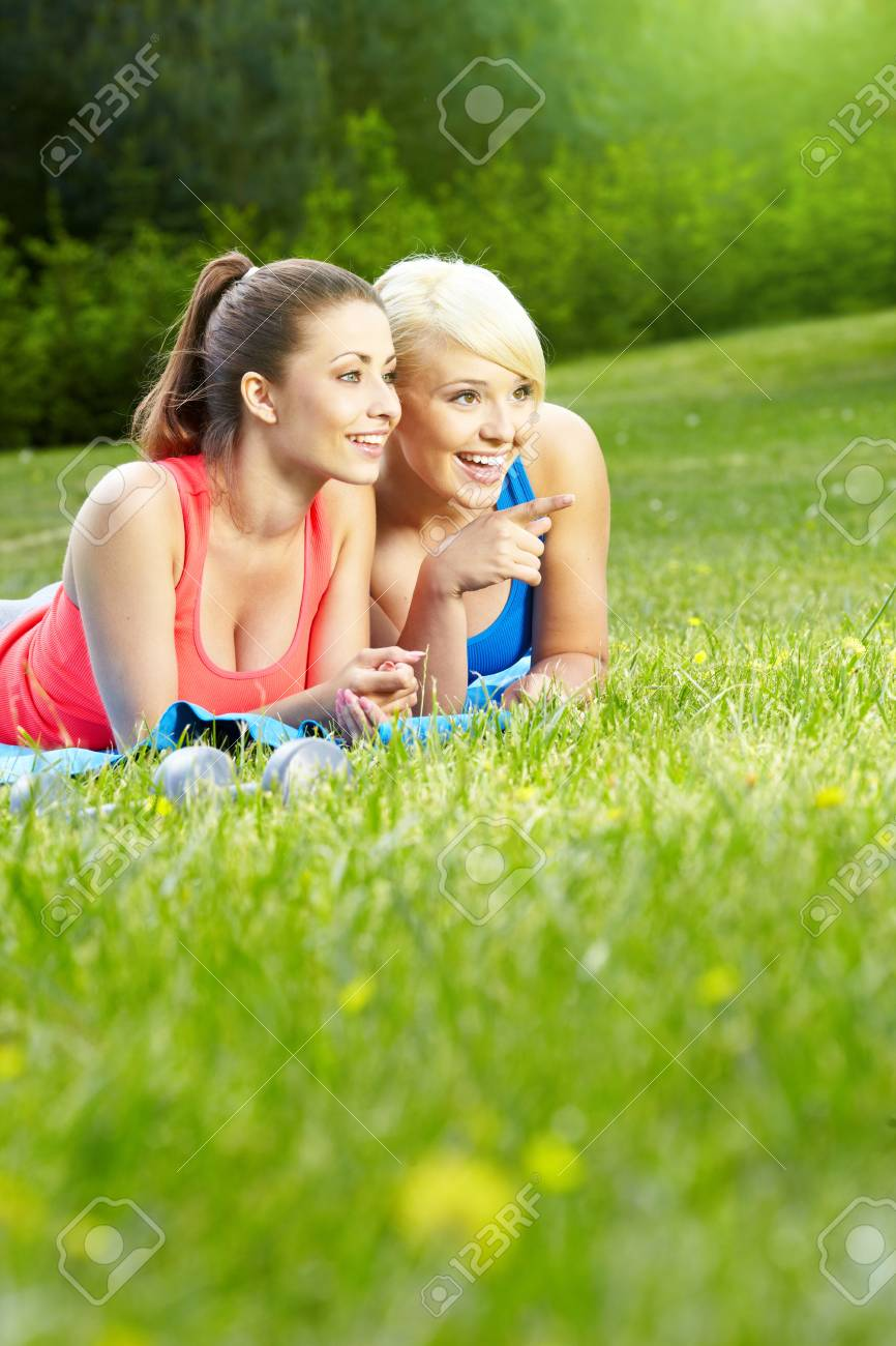 Two smiling fitness girls outdoor Stock Photo - 13876752