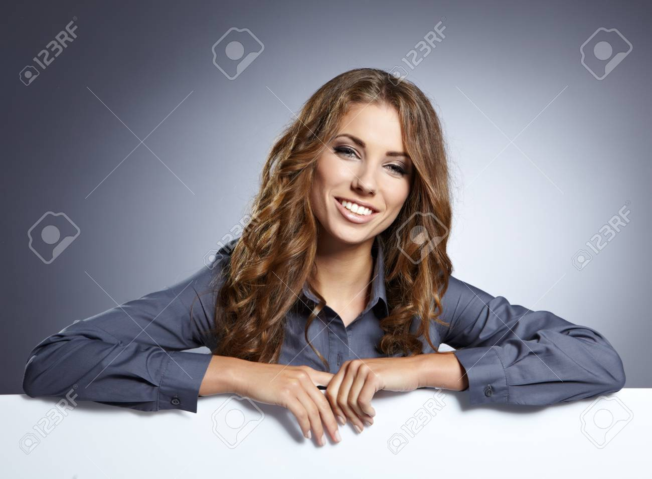 young business woman showing blank signboard, isolated over grey  background Standard-Bild - 14992421