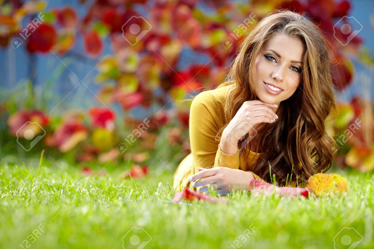 beautiful with book in the autumn park stock photo picture