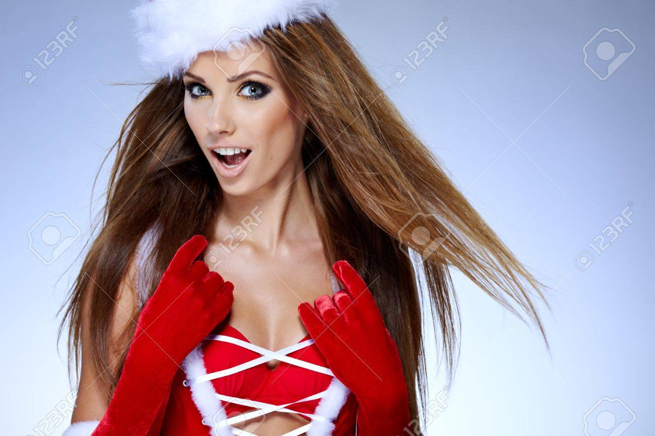 beautiful sexy girl wearing santa claus clothes with christmas gift Stock Photo - 15610587