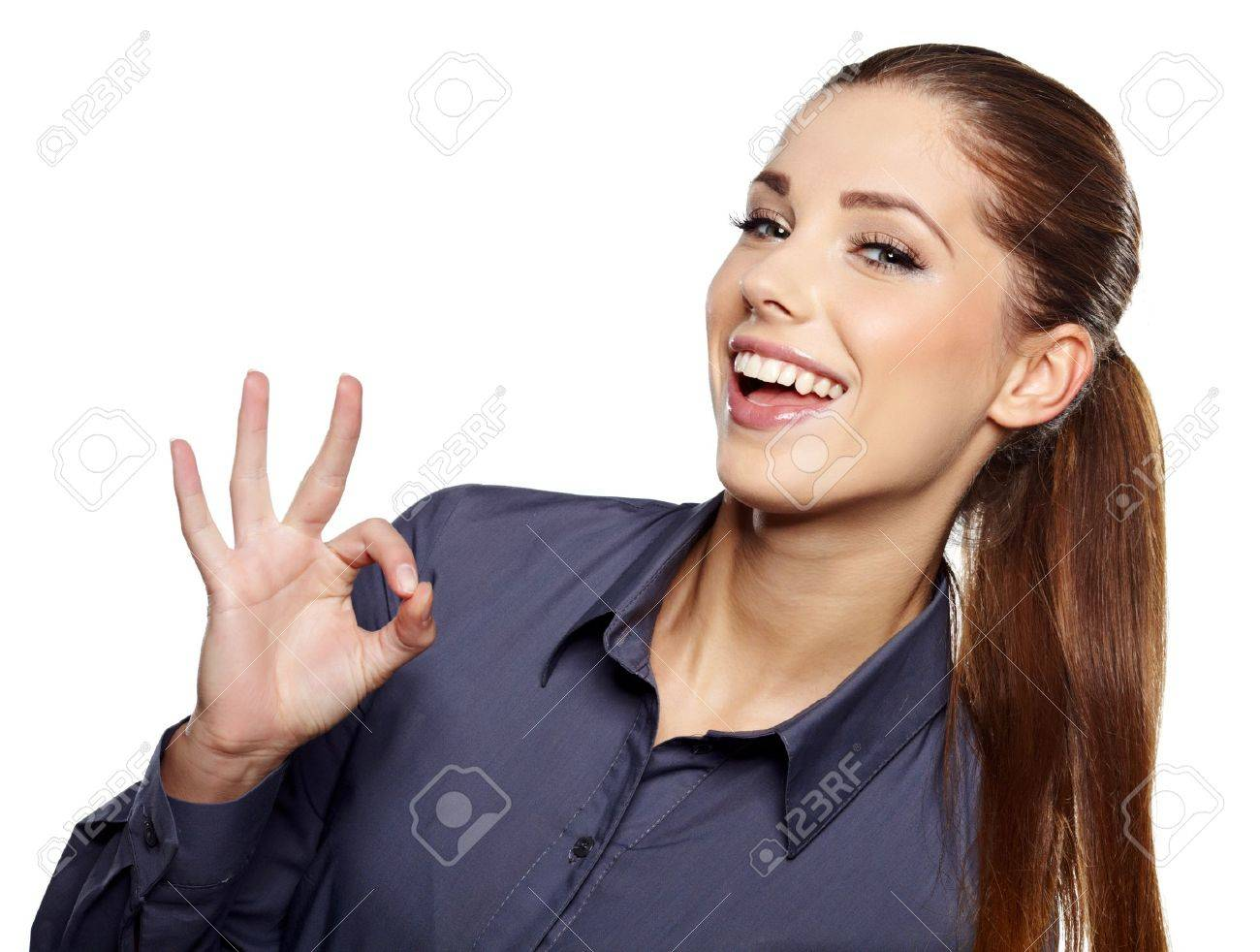 Happy smiling business woman with ok hand sign Stock Photo - 15918552
