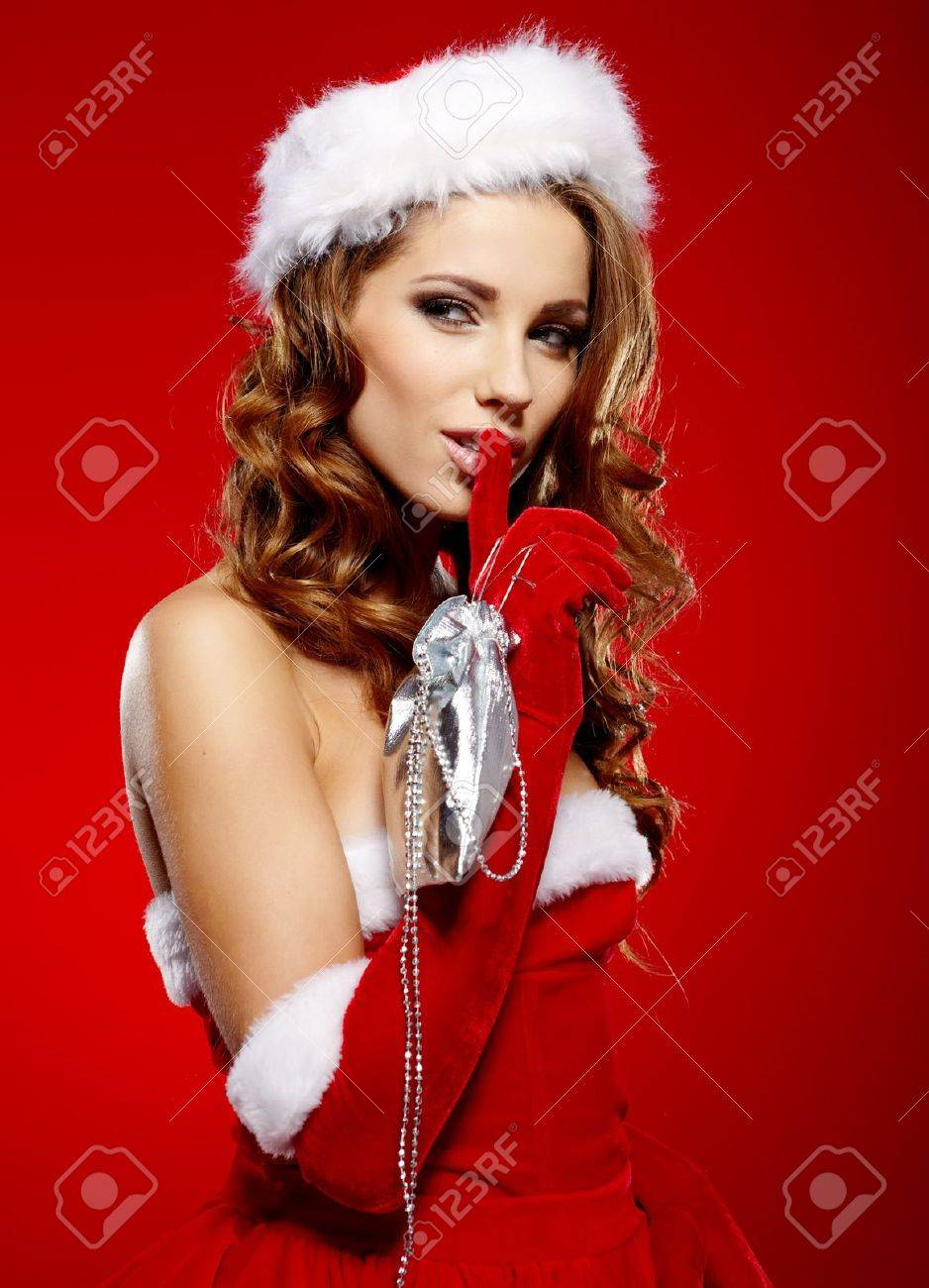 Portrait of beautiful sexy girl wearing santa claus clothes on red background Stock Photo - 16038853