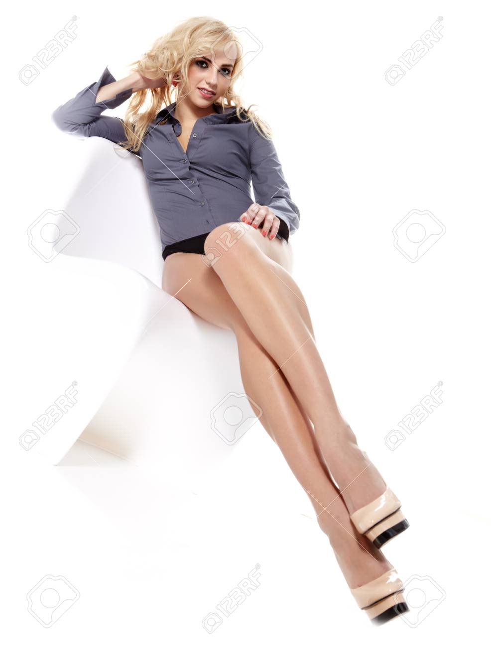 Attractive beautiful young blonde posing on a white Stock Photo - 16333367