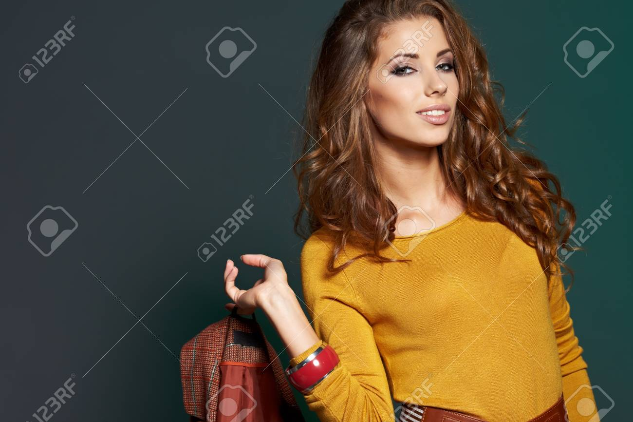 fashionable woman in a autumn color in light background Stock Photo - 16333427