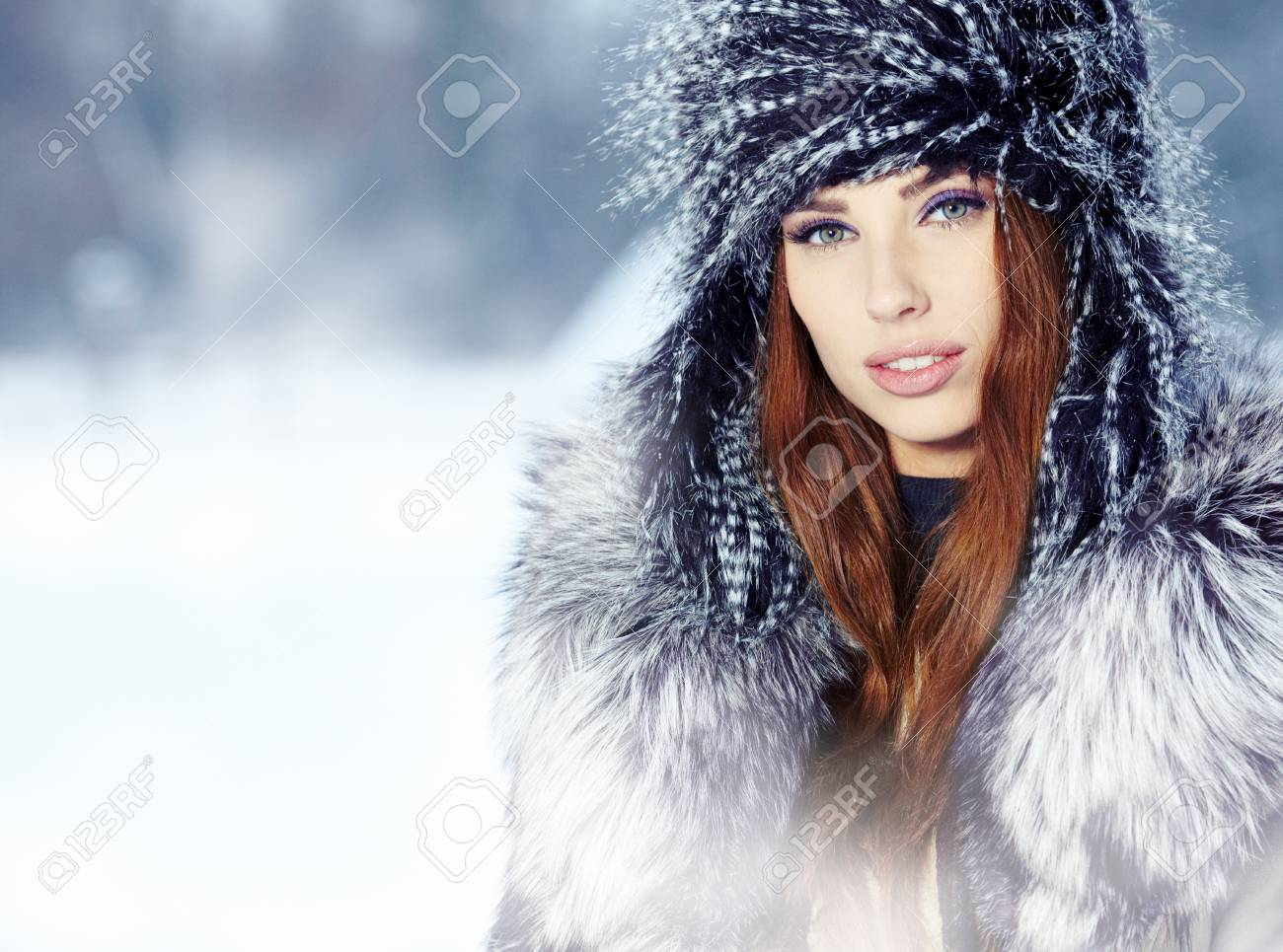 a beauty girl on the winter background Stock Photo - 17130056